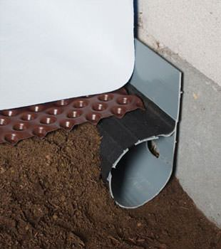 Closeup of a crawl space drainage system installed in Brigham City