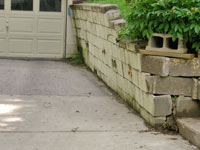 a failing retaining wall around a driveway in Salt Lake City