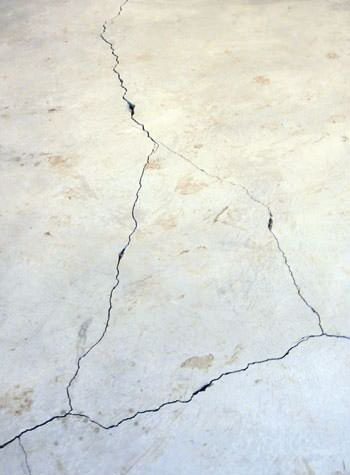 severely cracked, heaving slab floors in a home in Spanish Fork