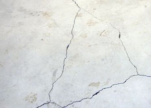 cracks in a slab floor consistent with slab heave in American Fork.
