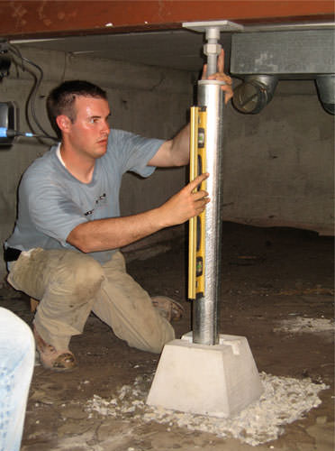A Contractor In Layton Installing A Crawl Space Jack Post.