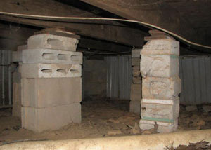 crawl space repairs done with concrete cinder blocks and wood shims in a American Fork home
