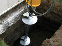 Installing a helical pier system in the earth around a foundation in Provo