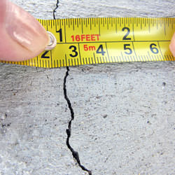 A crack in a poured concrete wall that's showing a normal crack during curing in Springville