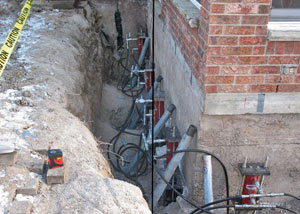 Foundation push piers installed around a house with a foundation settlement issues in Brigham City