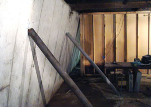 A severely tilting foundation wall propped up by steel beams in Centerville.