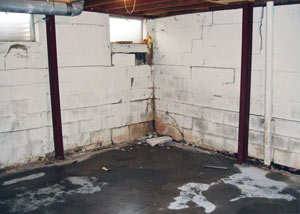 A failed, rusty i-beam foundation wall system installed in Brigham City.