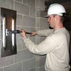installing a wall anchor to repair an bowing foundation wall in Orem