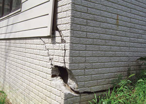 A severely damaged foundation wall in Sandy