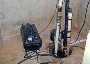 Pedestal sump pump system installed in a home in Roy