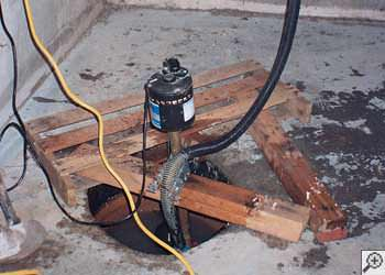 A Roy sump pump system that failed and lead to a basement flood.