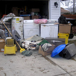 Soaked, wet personal items sitting in a driveway, including a washer and dryer in Tooele.