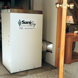A basement dehumidifier with an ENERGY STAR® rating ducting dry air into a finished area of the basement  in Springville