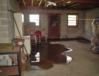 a flooded basement floor in a Springville home