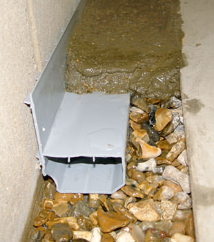 A basement drain system installed in a Tooele home